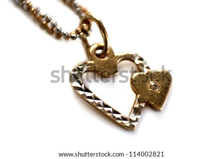 Two gold hearts on chain isolated on white - St. Valentine's Day