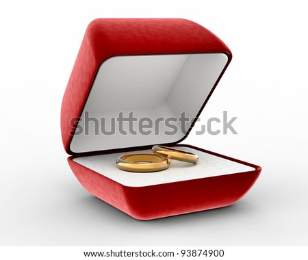 Two gold wedding rings in red present box