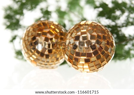 Two golden christmas balls on the firtree