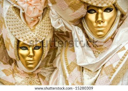Two golden mask in Venice, Italy.