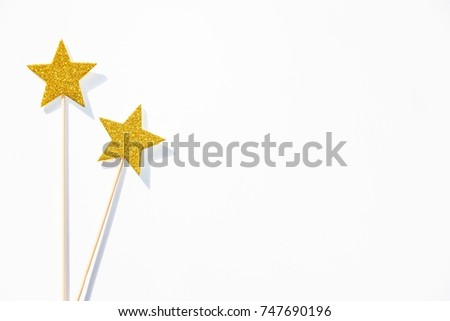 Two golden party magic wands on a white background. Copy space.  #747690196