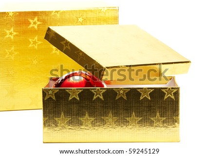 two golden present boxes with one red shiny christmas ball on white background