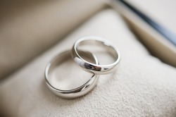 Two golden wedding rings. Close-up view of white golden wedding rings in a box