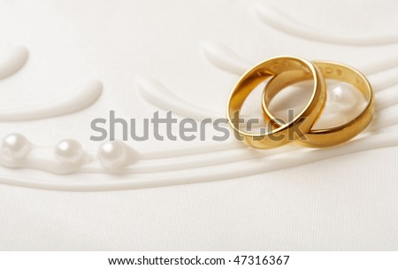 stock photo two golden wedding rings wedding invitation