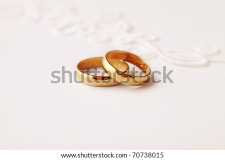 stock photo two golden wedding rings wedding invitation