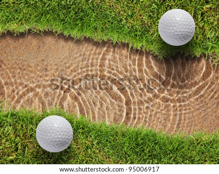 Two golf ball on fresh green grass near water bunker in golf course