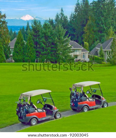 Two golf cars on the path with nice neighborhood and a mountain as a background.
