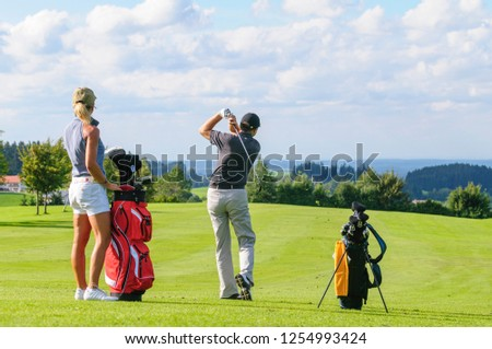 two golfers playing on fairway