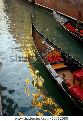 Two Gondolas in Venice with sky reflecting in the water