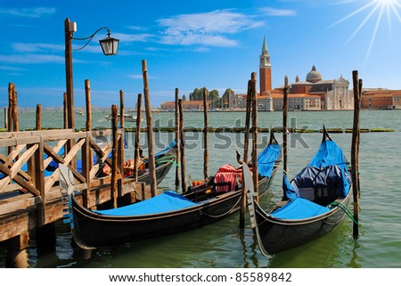 Two gondolas on the San Marco canal and Church of San Giorgio Maggiore in Venice, Italia