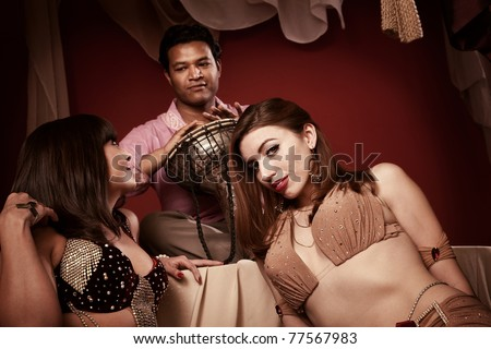 Two gorgeous belly dancers with handsome Indian dummer