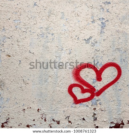 Two Graffiti Love Red Heart Painted On White Concrete Wall. Concept For Love Emotion Or Valentine Day. Abstract Love Vertical Background Or Texture With Copy Space