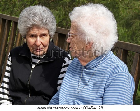 Two gray-haired women.