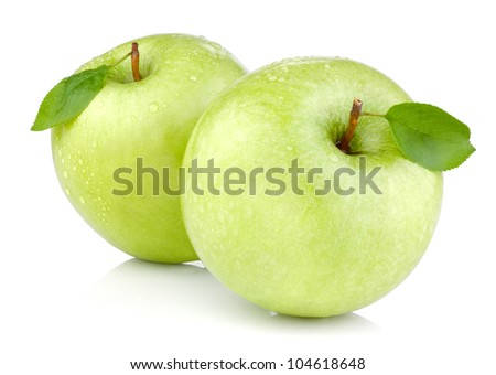 Two green apples with leaves and drops of water isolated on a white background
