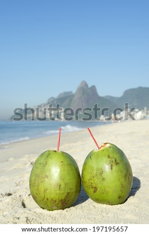 65a646e19ec Two green coconuts on Ipanema Beach against a backdrop of Two Brothers Dois  Irmaos Mountain Rio
