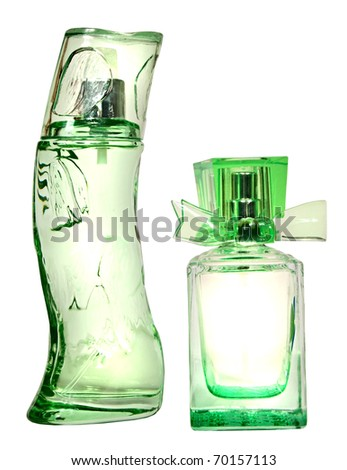 Two green glass bottles of female perfume isolated on a white background - stock photo