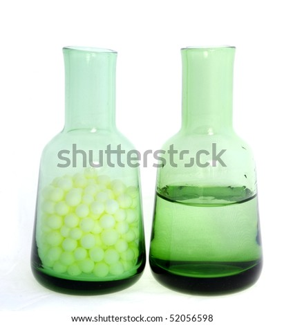 Two green glass bottles on white