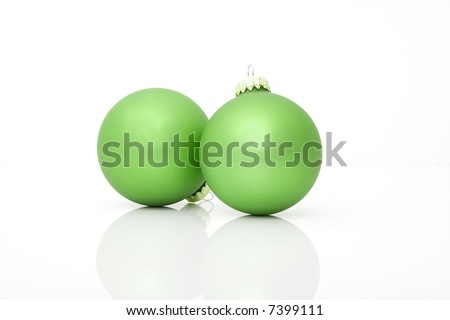 two green ornaments isolated against white background