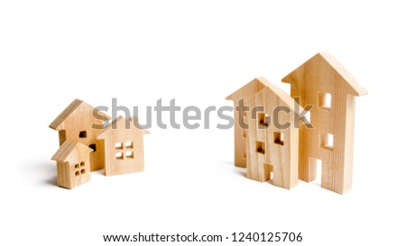 Two groups of wooden houses of different size. Choose between city and suburb, or village. Building density and number of floors. Rethinking urbanization and friendly urban infrastructure