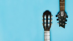 two guitars on a blue background