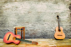 two guitars with the old peeled plaster