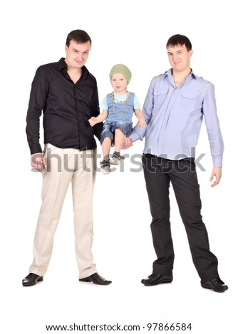 Two guys hold little boy on at white background