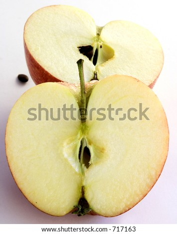 Two halfs an apple over a white background