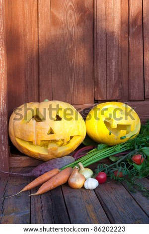 Two Halloween pumpkins and autumn harvest