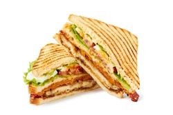 Two halves of club sandwich on white