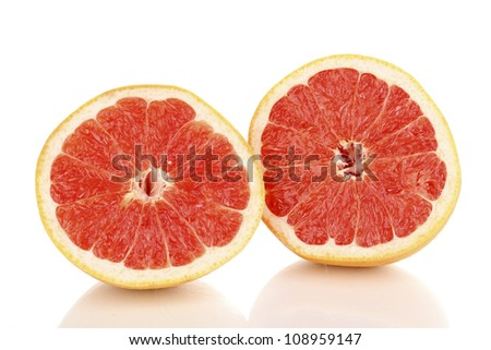 Two halves of ripe grapefruit isolated on white #108959147