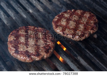 Two Hamburgers on Barbeque Grill
