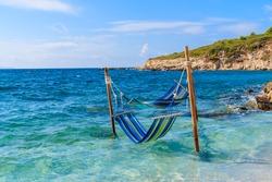 Two hammocks in sea water in beautiful Proteas bay, Samos island, Greece