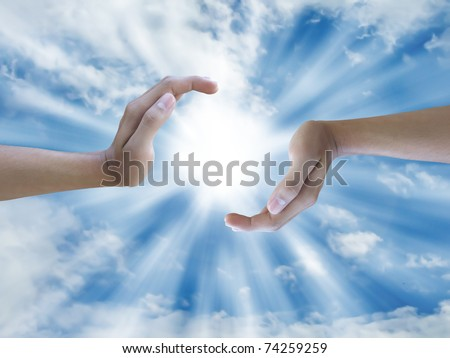 two hand holding the sun