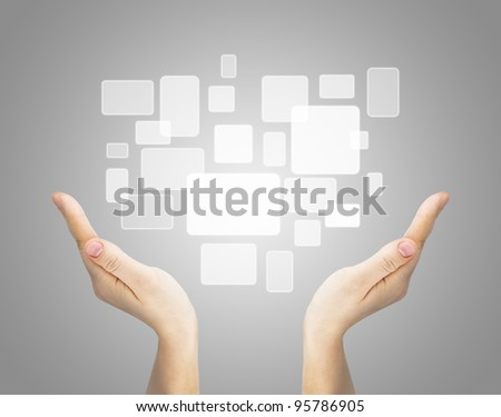 Two hand holding touch screen on gray background
