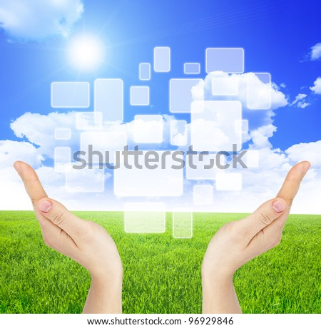 Two hand holding touch screen on nature field background - stock photo