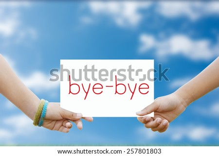Two hand holds a sign for the bye-bye