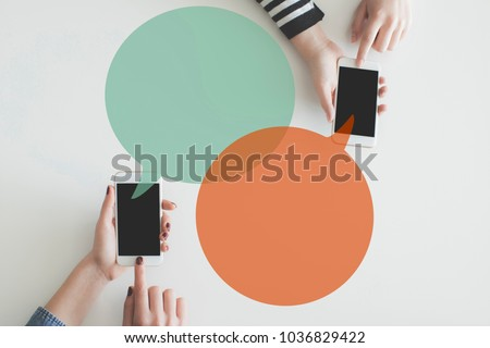 Two hand mobile phones sending message each other