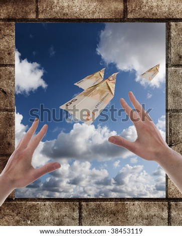 two hand on the window with wall and euro planes