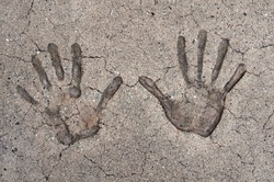 Two hand prints in cement