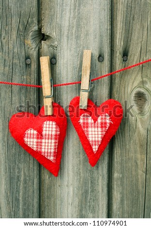 two hand-stitched heart made ??of red felt