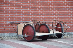 Two handcart in front of the red brick.