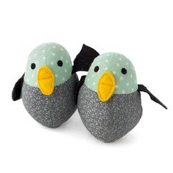 Two handmade textile, turquise, yellow, black and gray toy birds isolated on white