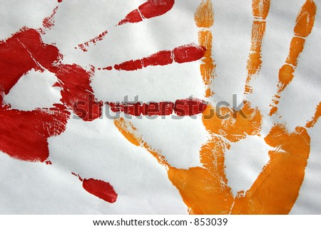 Two handprints made with paint on paper.