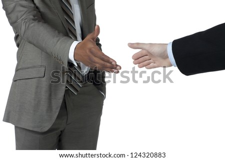 Two Hands About to shake in a cropped image - stock photo
