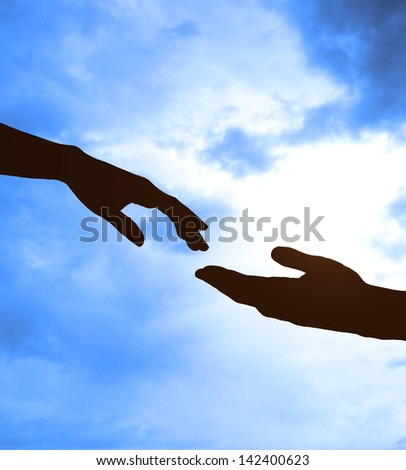 two hands and sky on background