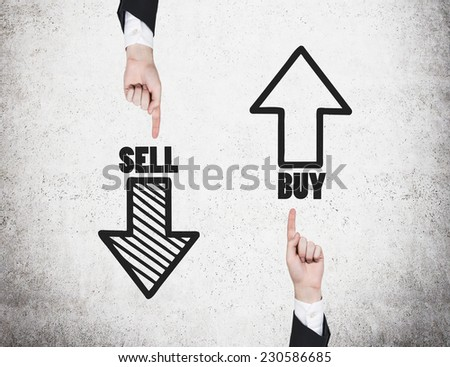 Two hands are pointing out the choices \'sell or buy\'.