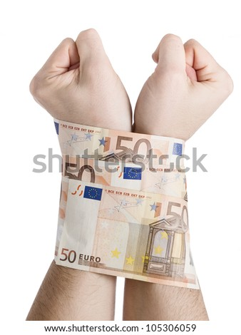 Two hands cuffed by 50 euros. The picture is intended to convey the concept of the global economic crisis we are experiencing the pressure as well as markets and banks over the population