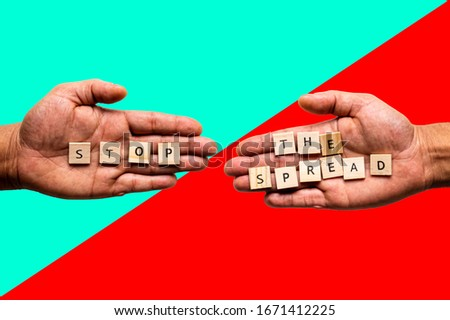 Two hands display the message 'STOP THE SPREAD'. Public health concept. Stock photo ©