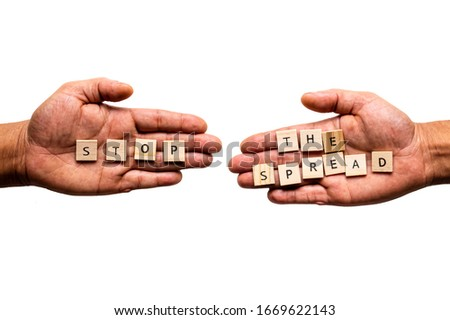 Two hands display the message 'STOP THE SPREAD'. Public health transmission concept. Stock photo ©