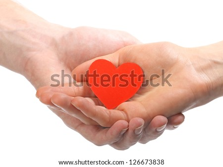 Two hands (female and male) holding red Valentine's heart